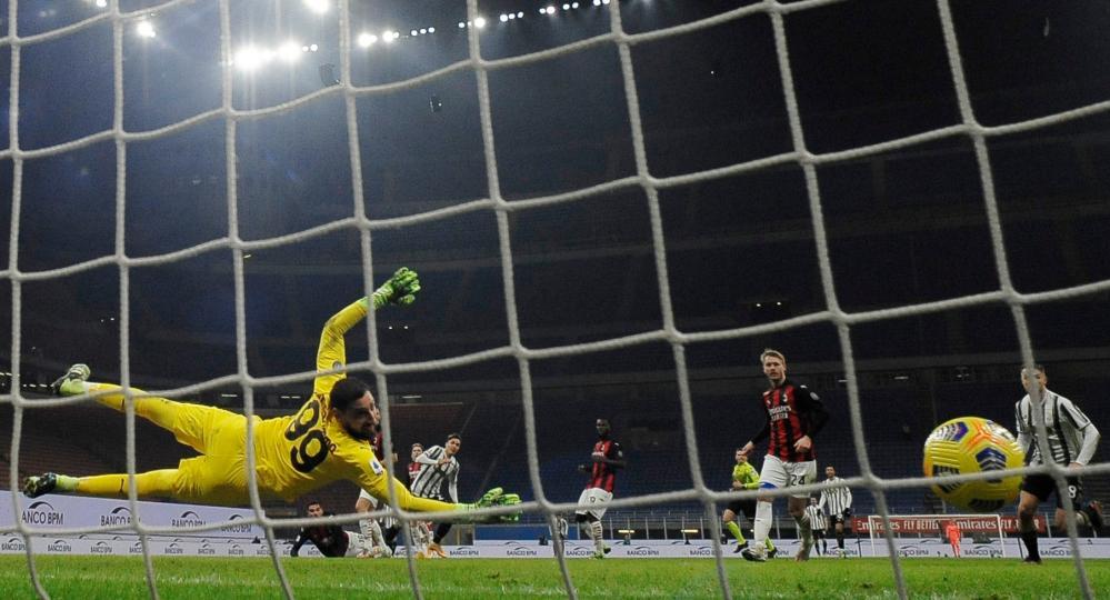 Juventus' Federico Chiesa scores their second goal.