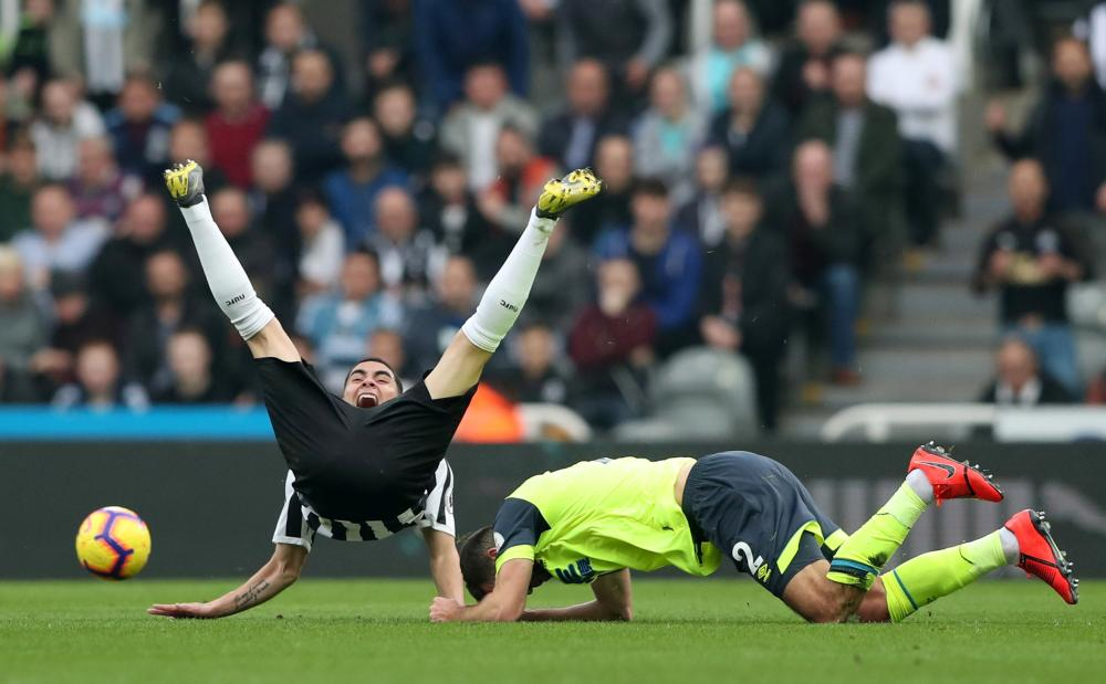February 23: Newcastle United's Miguel Almiron reacts after a challenge from Huddersfield Town's Tommy Smith which led to a red card.
