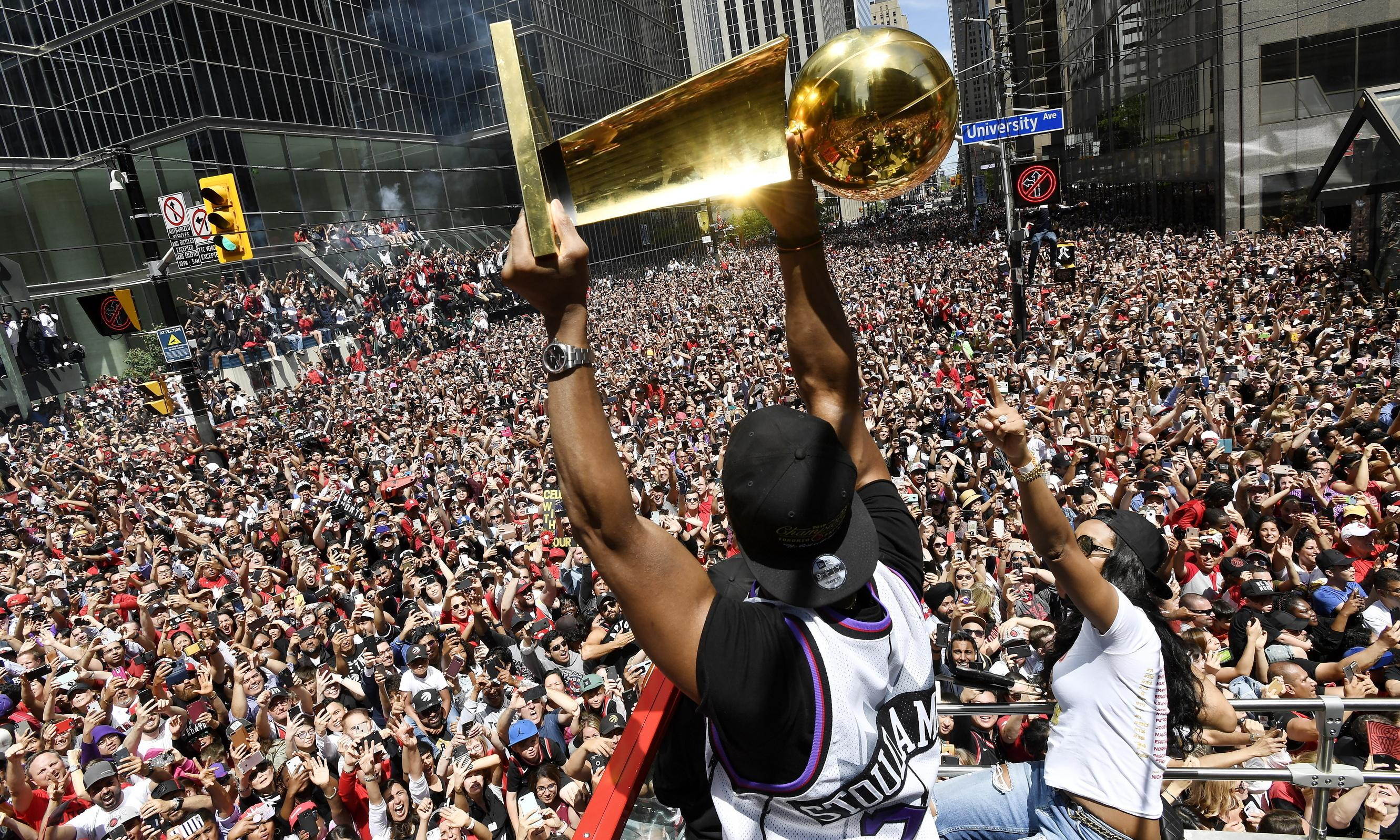 Police say two shot as 1.5m pack Toronto streets for Raptors' title parade