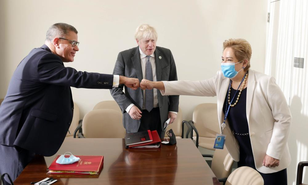 The UK prime minister, Boris Johnson (centre) and the Cop26 president, Alok Sharma (left), meeting with the executive secretary of the UN Framework Convention on Climate Change (UNFCCC), Patricia Espinosa, at the UN building in New York on 20 September 2021
