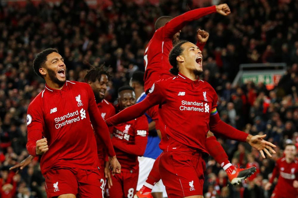 December 2:Liverpool's Virgil van Dijk and Joe Gomes celebrate Divock Origi's goal against Everton.