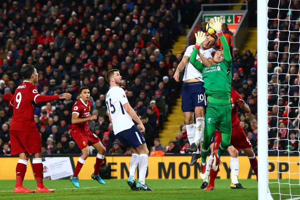 Karius, challenged by Kane.