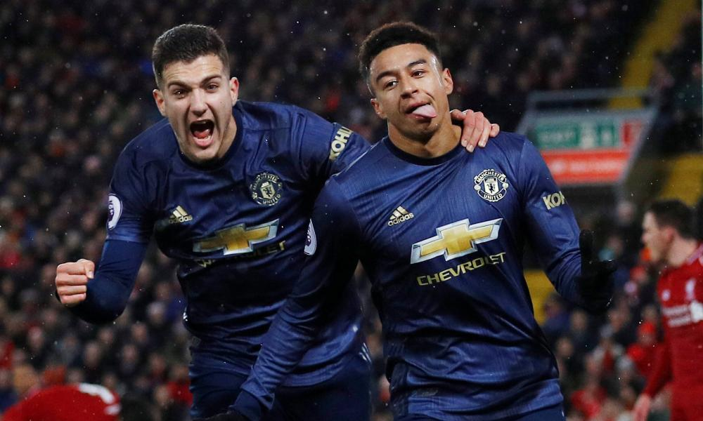 Manchester United's Jesse Lingard celebrates scoring their first goal with Diogo Dalot