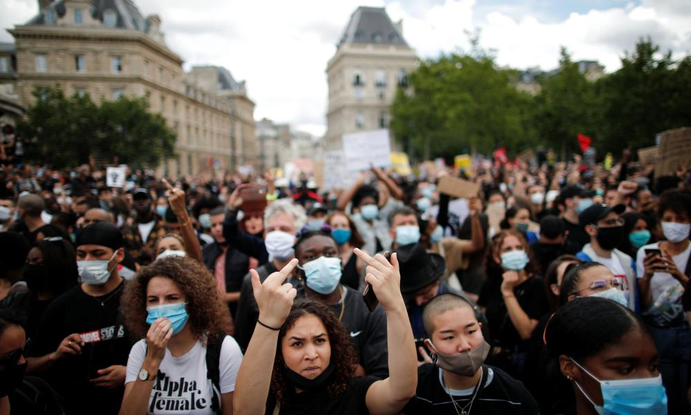 Demonstrators protest against police brutality and the death in Minneapolis police custody of George Floyd at the Place de la Republique square in Paris on Saturday.