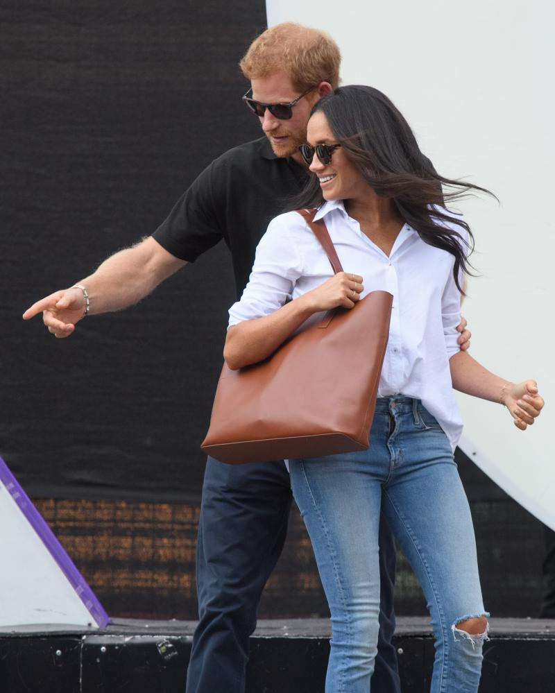 Meghan Markle in Misha Nonoo's Husband shirt … 'a perfect half-tuck into her jeans'.
