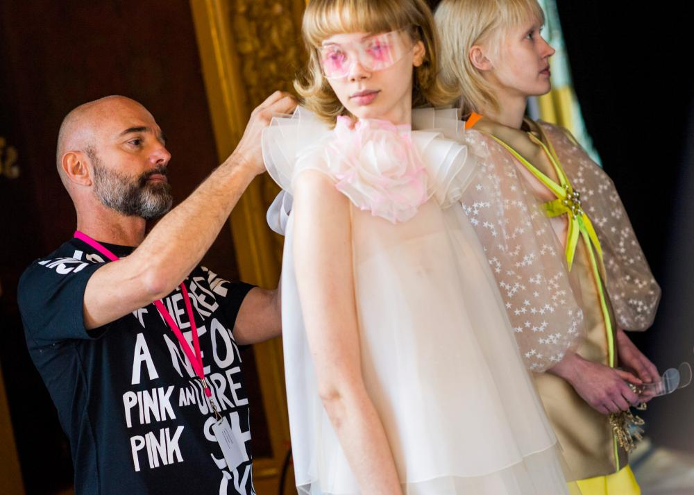 Bertrand Guyon, Schiaparelli's design diretor, at work backstage