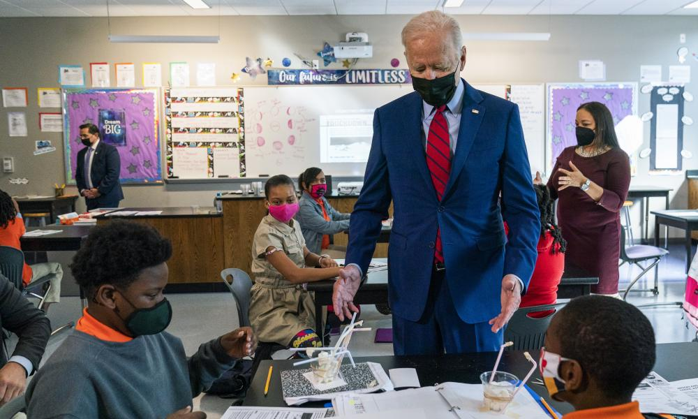 Joe Biden at Brookland middle school in Washington on Friday. Biden's move comes against a backdrop of vaccination rates that have stalled.