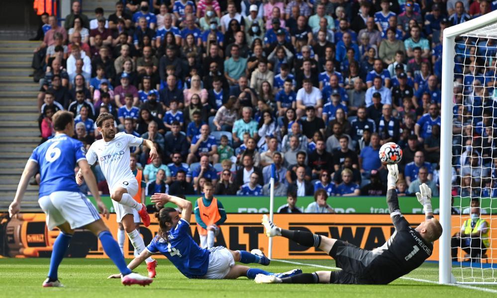 Bernardo Silva scores Manchester City's first goal past Leicester City keeper Kasper Schmeichel.