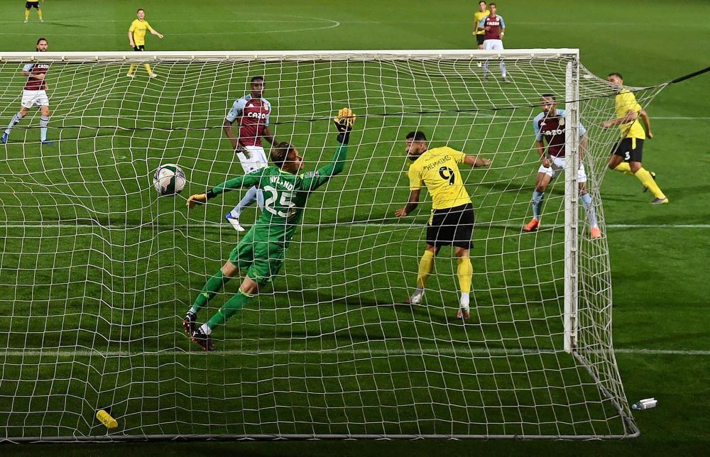 Burton Albion's Colin Daniel slams in the opening goal.