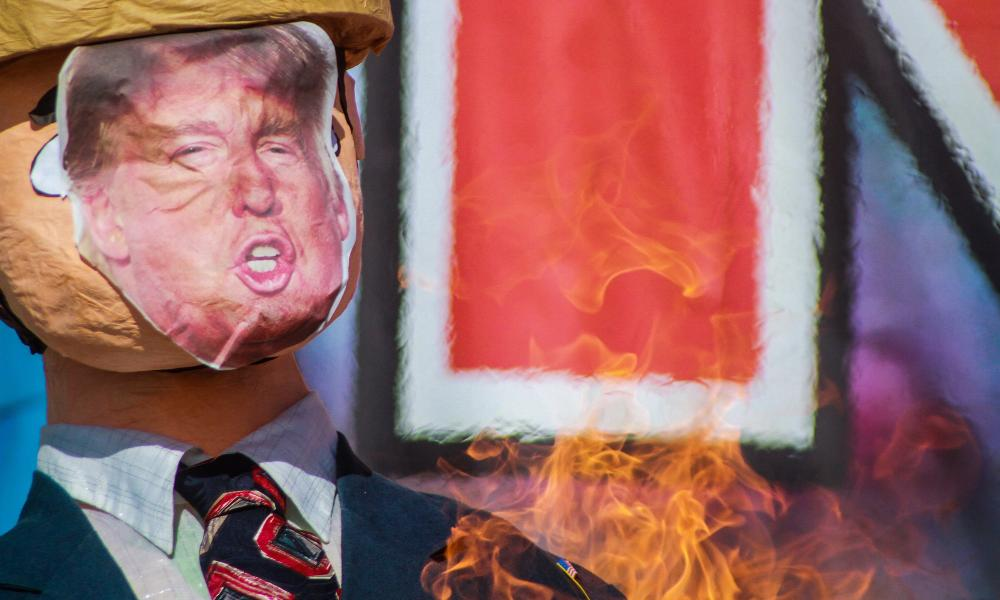 An effigy of Trump is burned during the protests.