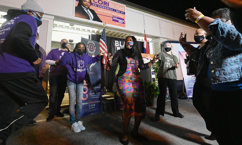 Cori Bush dances with supporters during her election night watch party at campaign headquarters in St Louis, Missouri