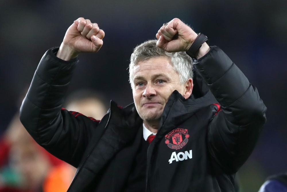 December 22: Manchester United's interim manager Ole Gunnar Solskjaer celebrates winning against Cardiff City.