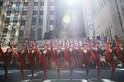 Members of the 'Radio City Rockettes' perform during their annual Christmas in August event outside of Radio City Music Hall in New York City. The Rockettes performed Sleigh Ride in the street while traffic was stopped on 6th Avenue.