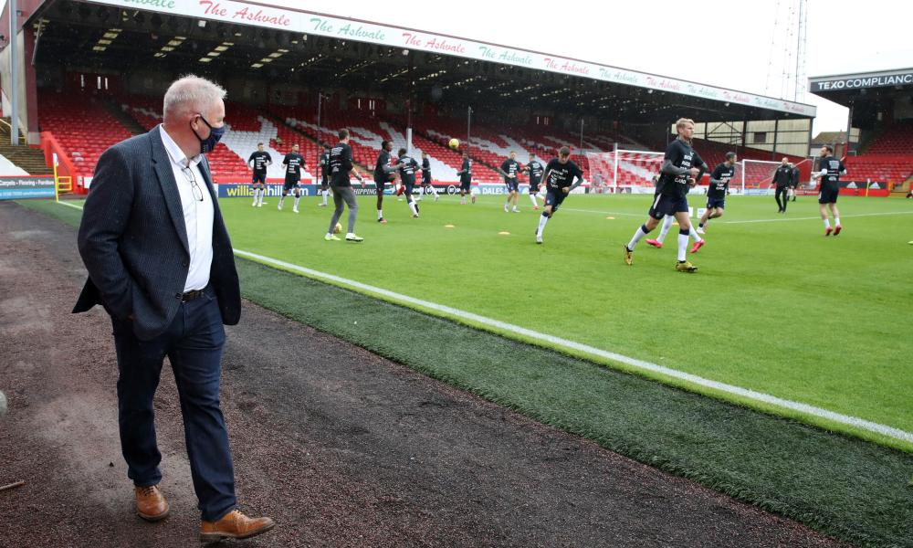 Former player Ally McCoist looks on as players warm up.