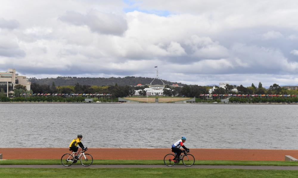 Two cyclists ride through Commonwealth Park in Canberra, Friday, 15 October 2021.