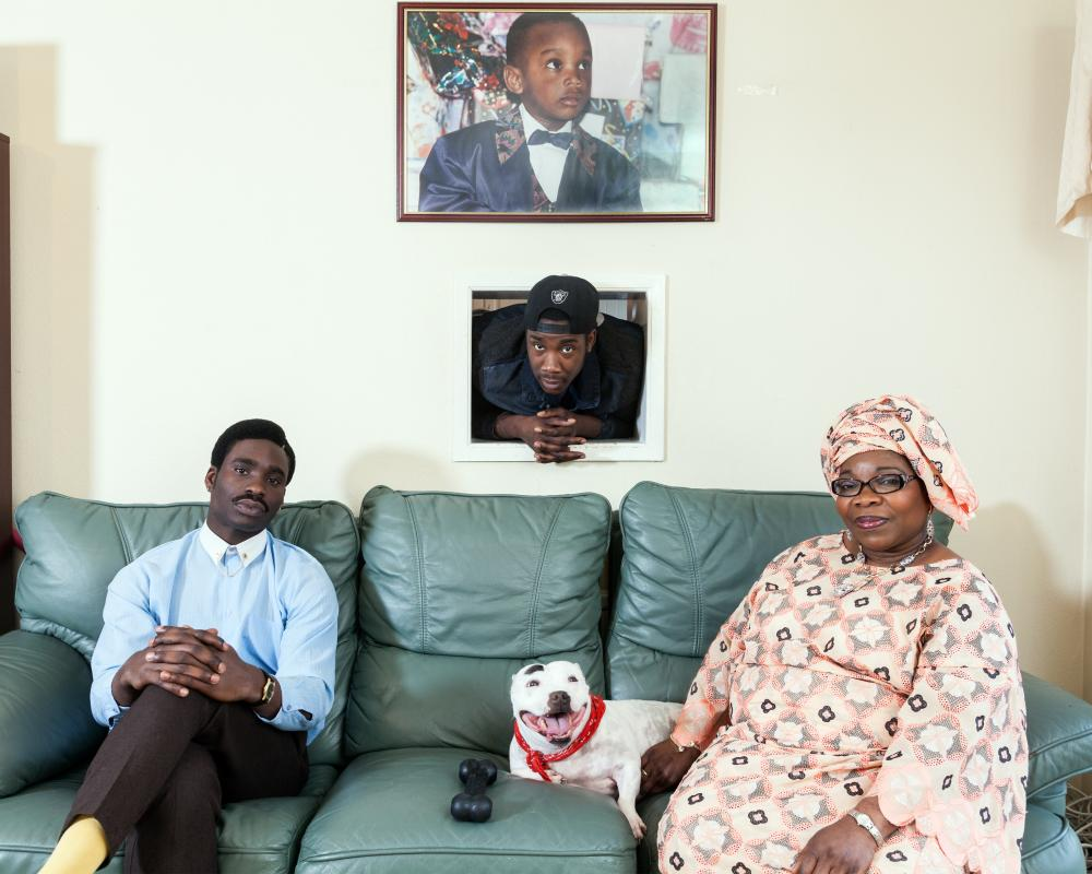 Joe Ogunmokun (on left) and his brother with their mother, from Nigeria