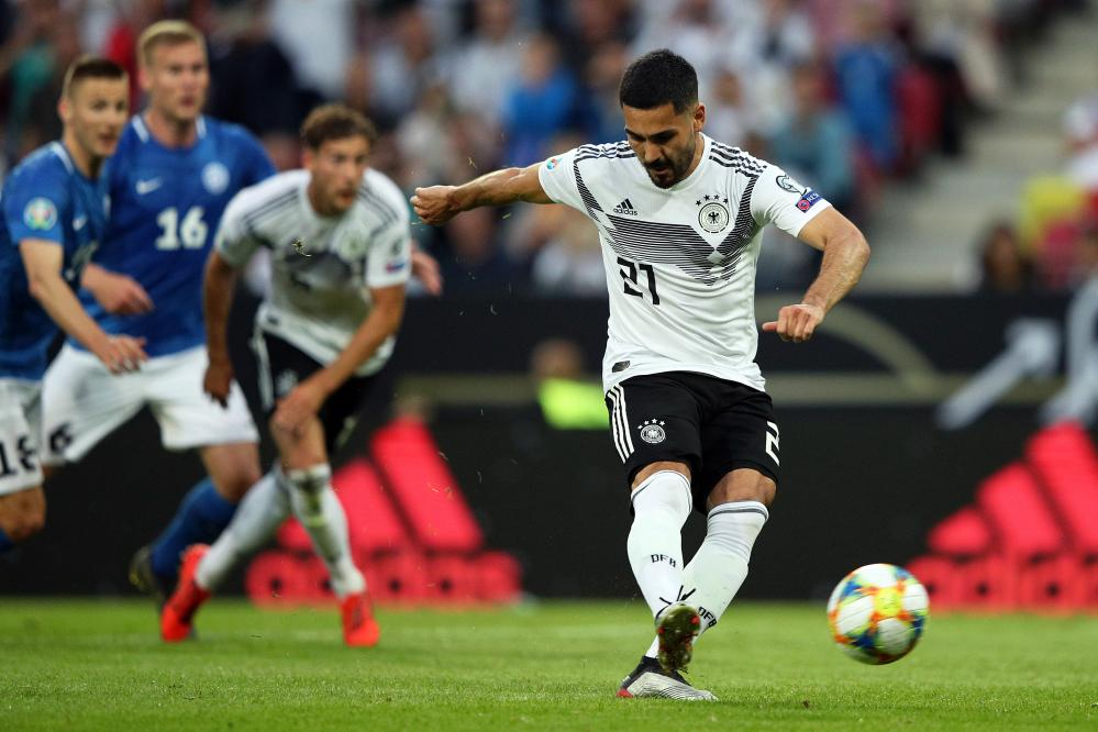 IIkay Gundogan sweeps the ball home from the penalty spot for Germany's fourth goal.
