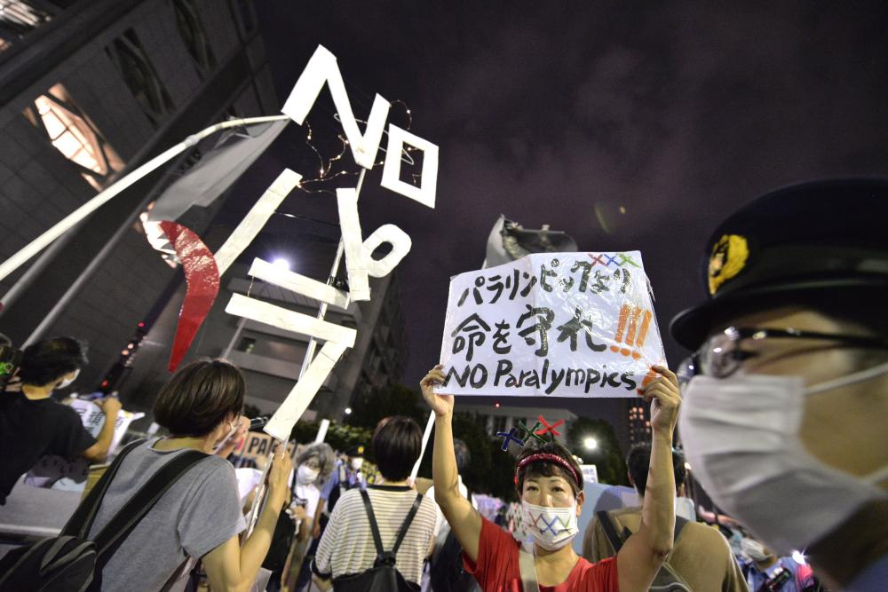 Protesters against the Tokyo 2020 Paralympic Games in front of the main gate during the opening ceremony.
