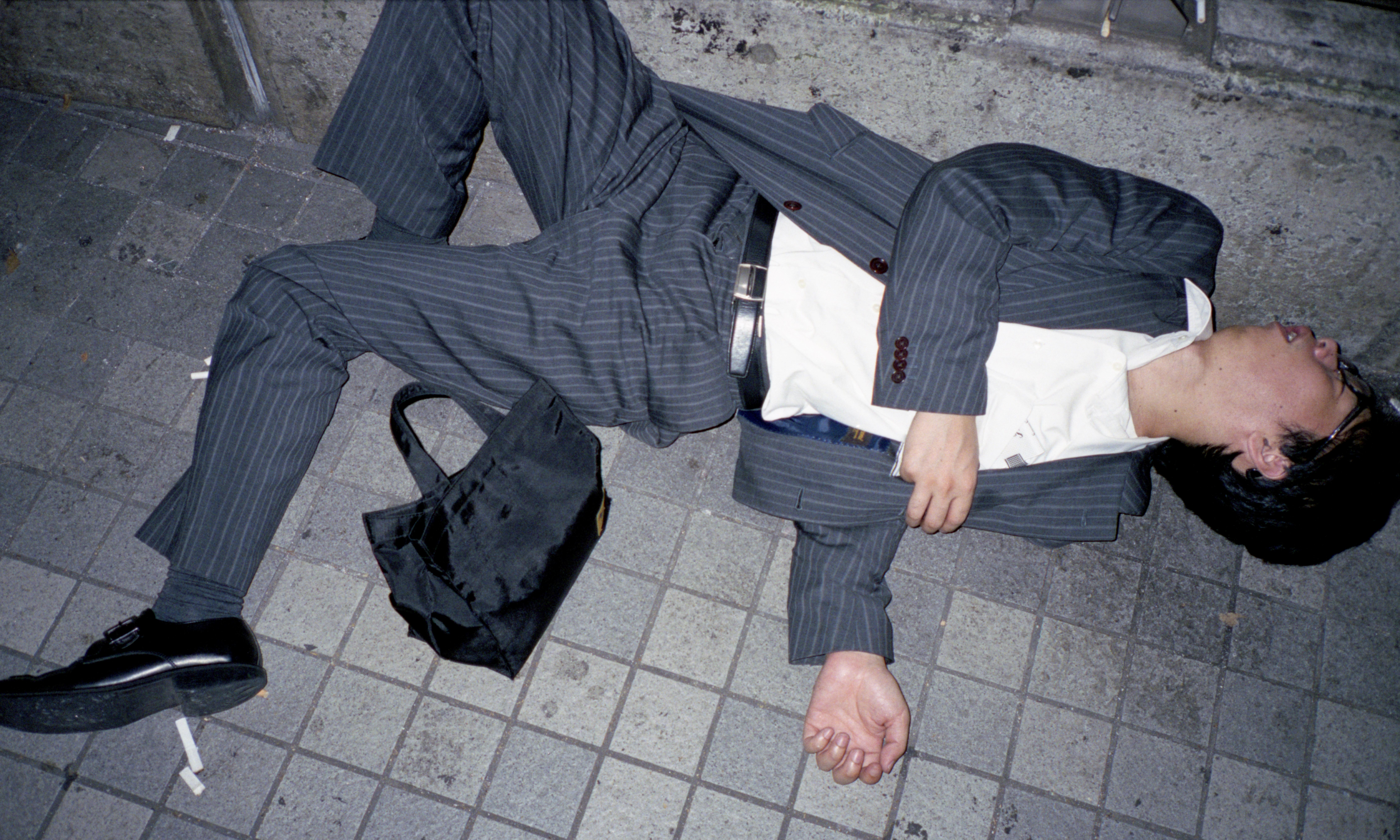 Legless Japanese businessmen: the photographer who caught a Tokyo epidemic