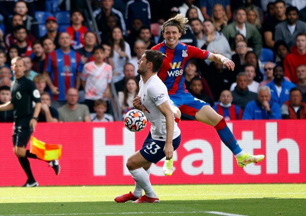 Tottenham Hotspur's Ben Davies concedes a penalty for handball.