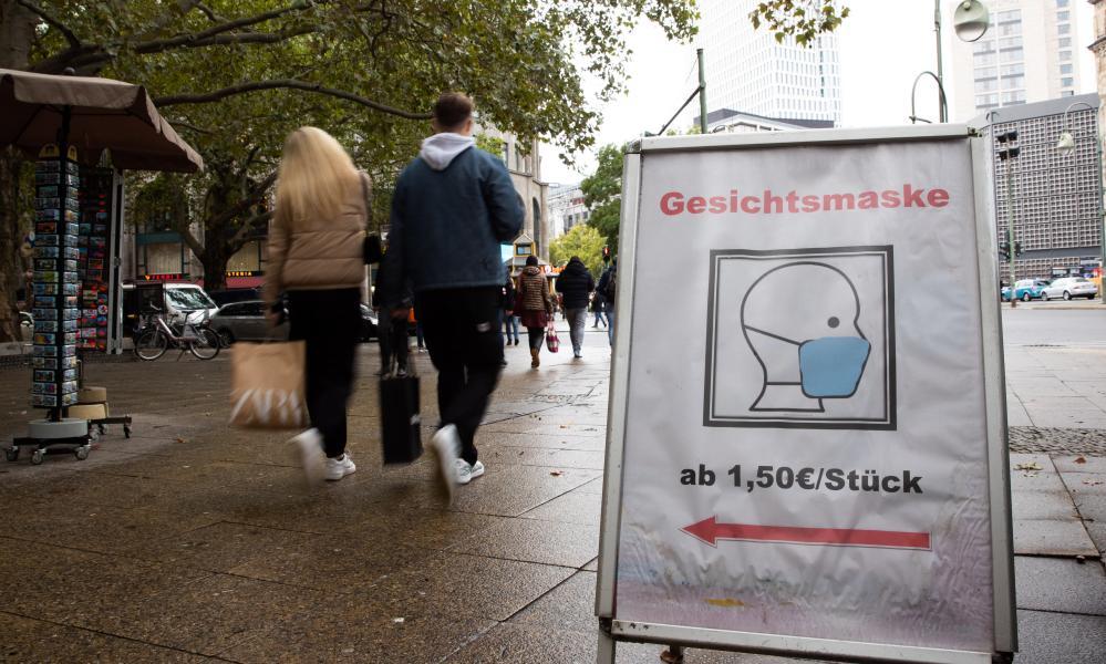 A sign advertising face masks on Berlin's famous Kurfürstendamm shopping street