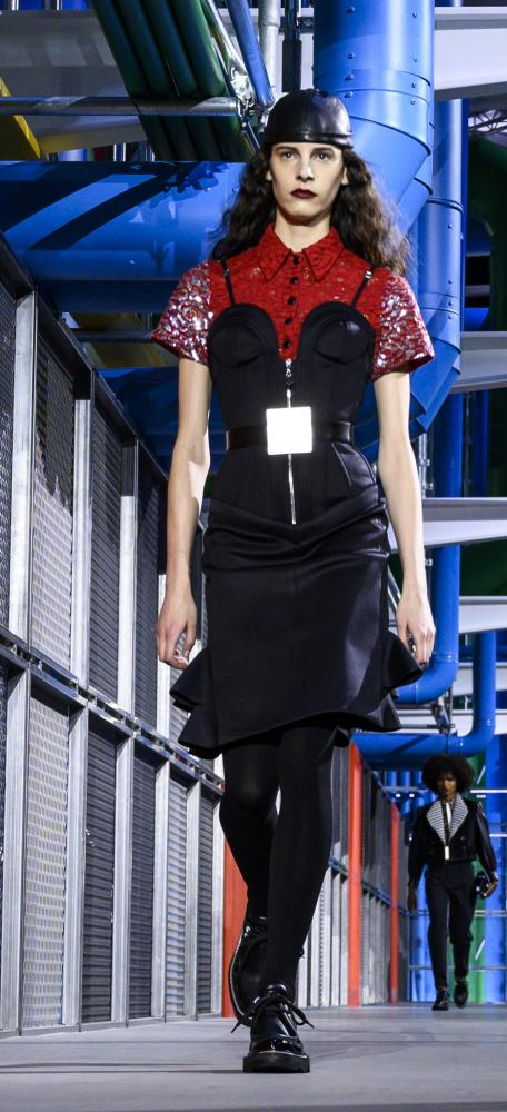 Grungy looks were teamed with flat shoes on the brightly coloured Louis Vuitton catwalk.