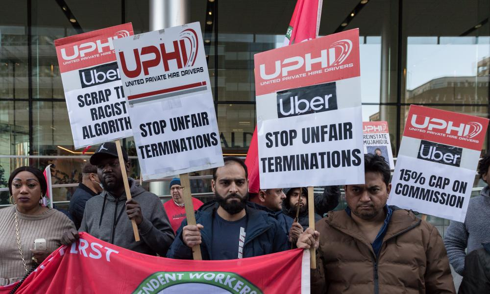 Uber drivers protest outside the company's London HQ during a 24-hour strike.