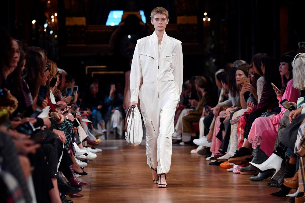 A model wears a cream boilersuit.
