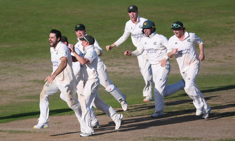 Brett Hutton is mobbed by his teammates after taking Saqib Mahmood's wicket to send Nottinghamshire to the summit.