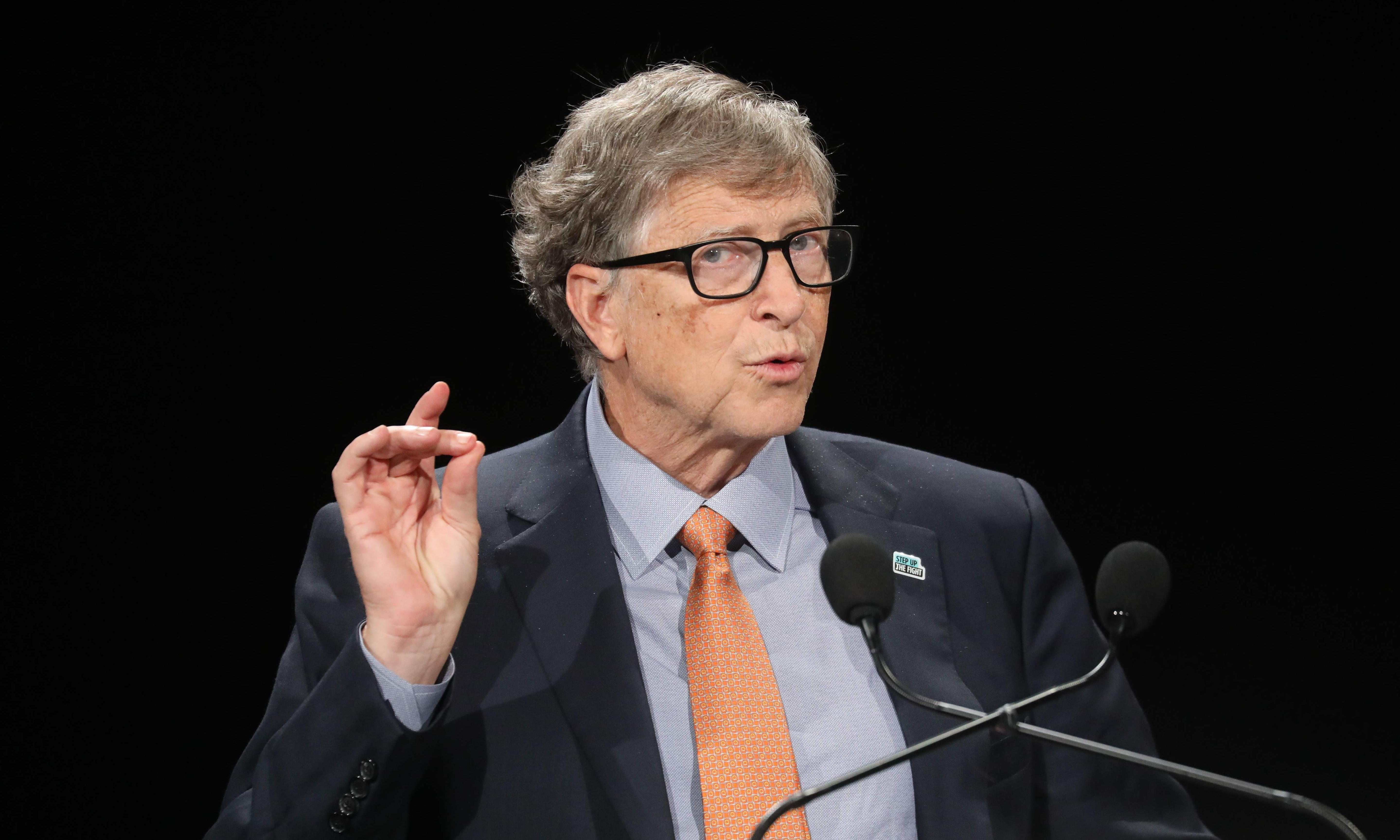 Striking sanitation workers decry low pay as company makes millions for Bill Gates