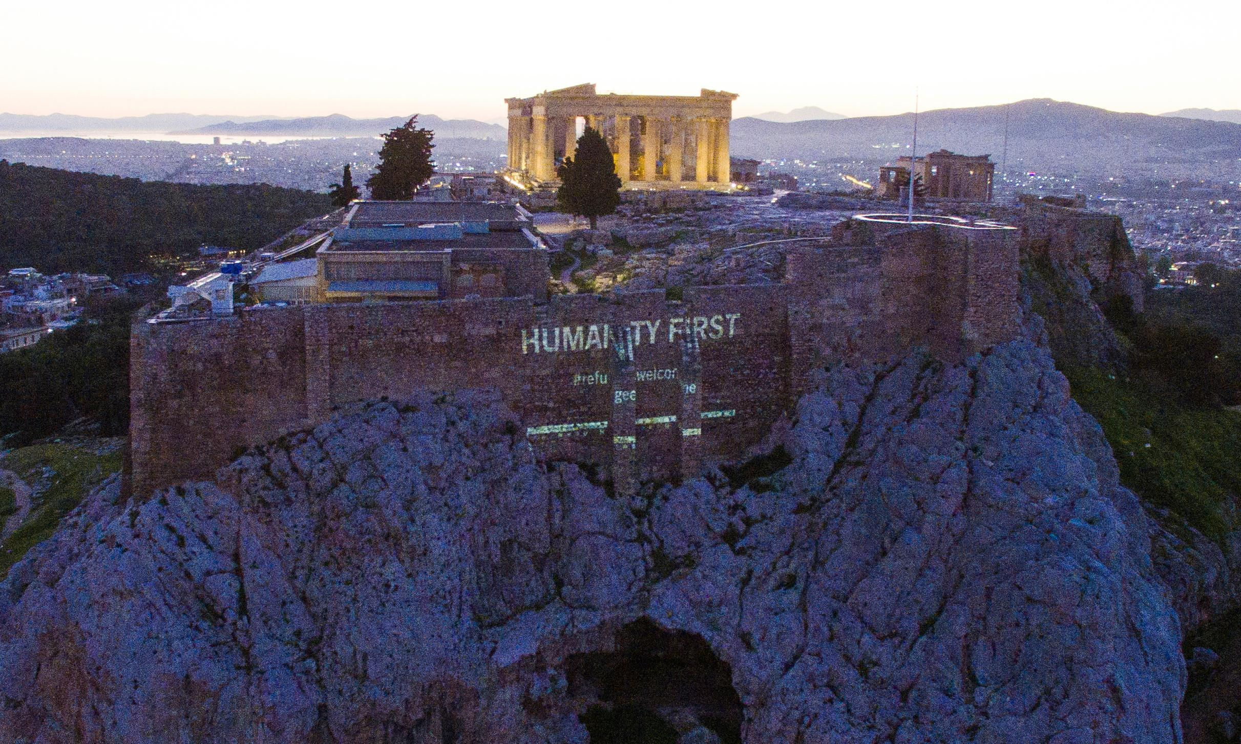 Activists project 'refugees welcome' on Acropolis to show crisis not over