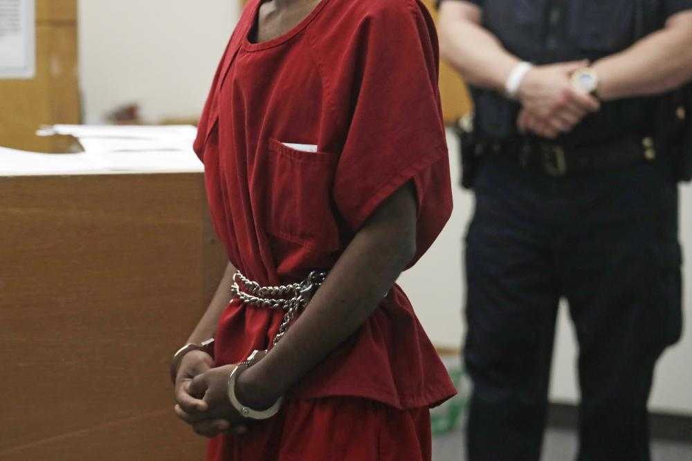 Dawit Kelete wears handcuffs chained to his waist as he walks into a court appearance on Monday, July 6, 2020, in Seattle
