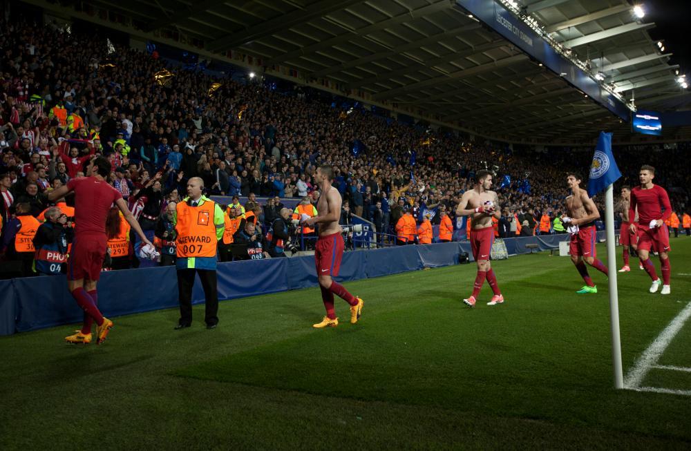 Atletico Madrid's Diego Godin, Gabi, Saul Niguez, Stefan Savic, Jose Gimenez and Lucas Hernandez throw their shirts to the Atletico fans.