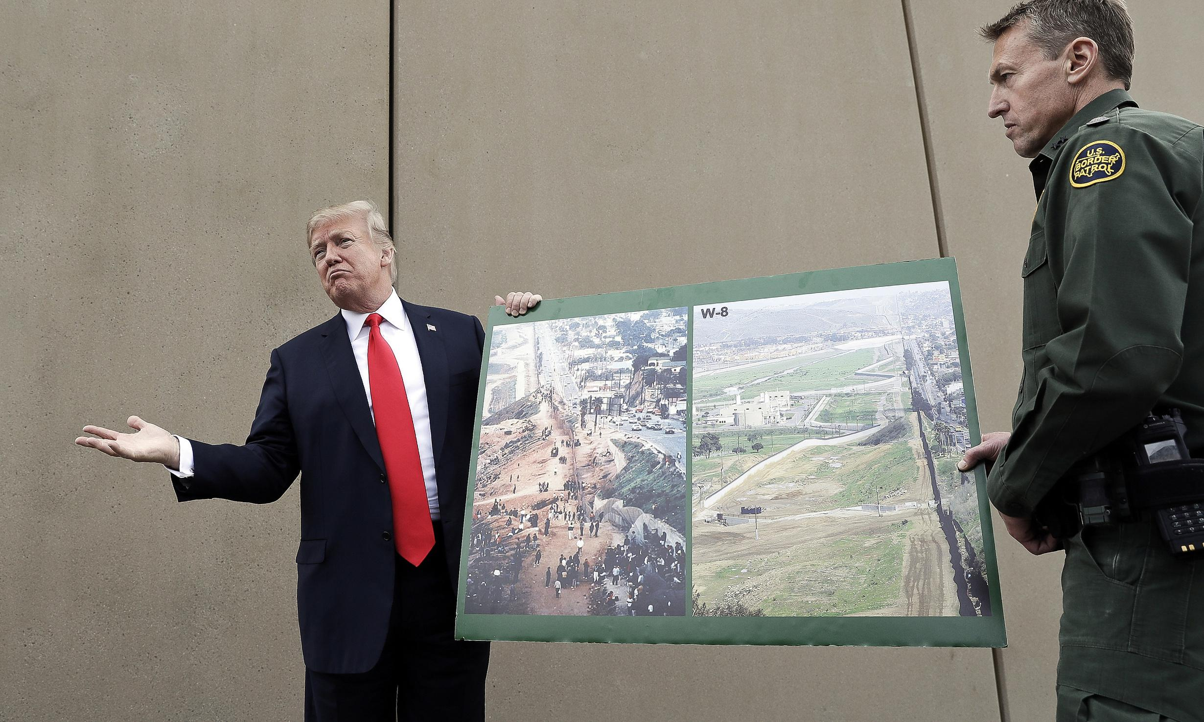 Judge bars Trump from building border wall sections with emergency funds