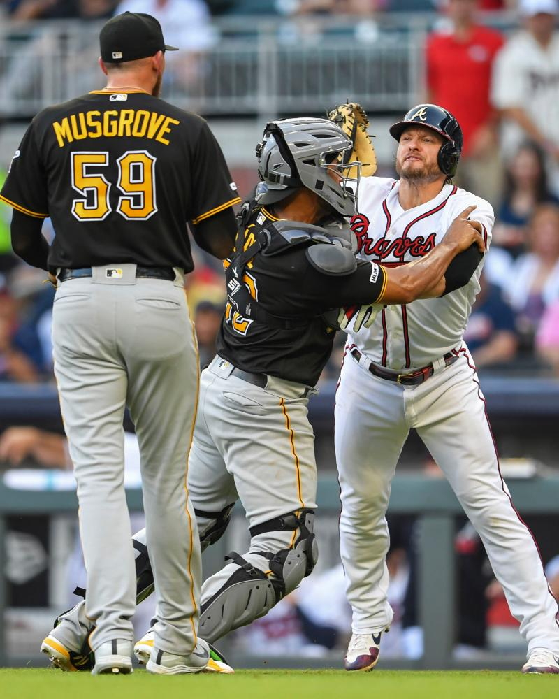Atlanta Braves third baseman Josh Donaldson (20) fights on the field with catcher Elias Diaz (32) and starting pitcher Joe Musgrove (59) after being hit by a pitch. And we're not even sure this one was intentional.
