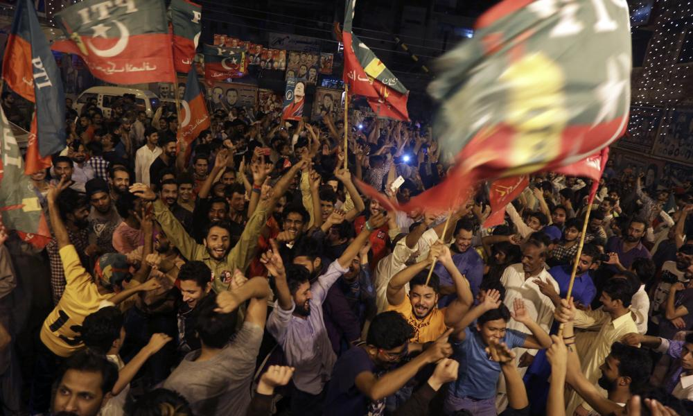 Supporters of Imran Khan celebrate projected unofficial results announced by television channels in Islamabad.