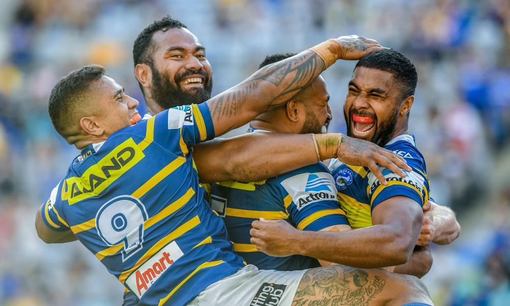 Parramatta Eels players celebrate a try