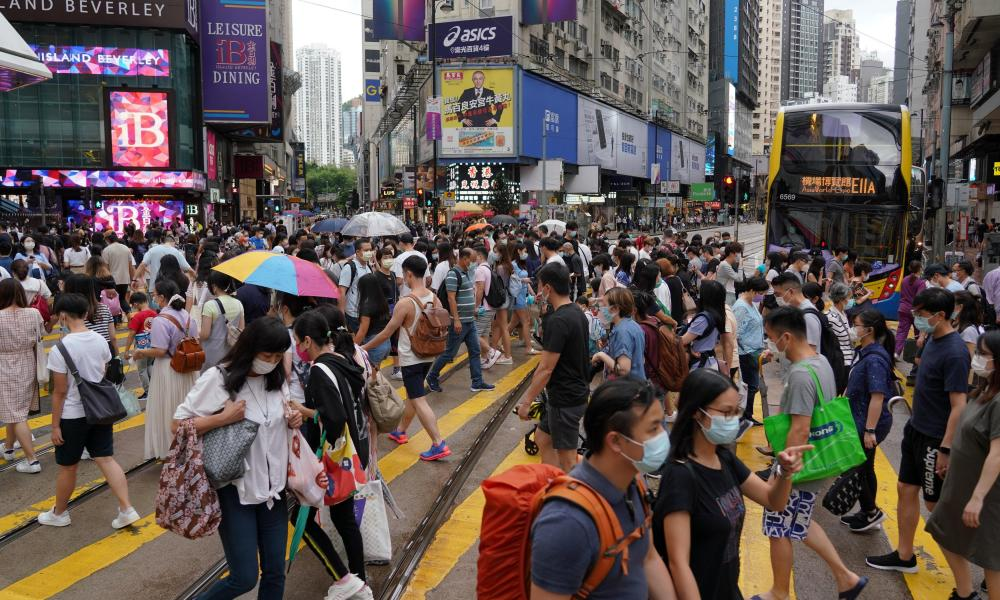 People wearing face masks cross a street at Causeway Bay amid the coronavirus outbreak on September 19, 2020 in Hong Kong, China.