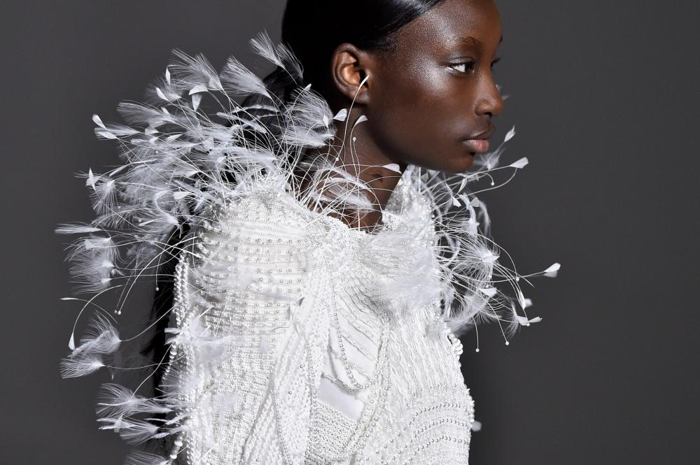 Feather and pearl detail on a white dress at Givenchy's spring/summer 2019 show