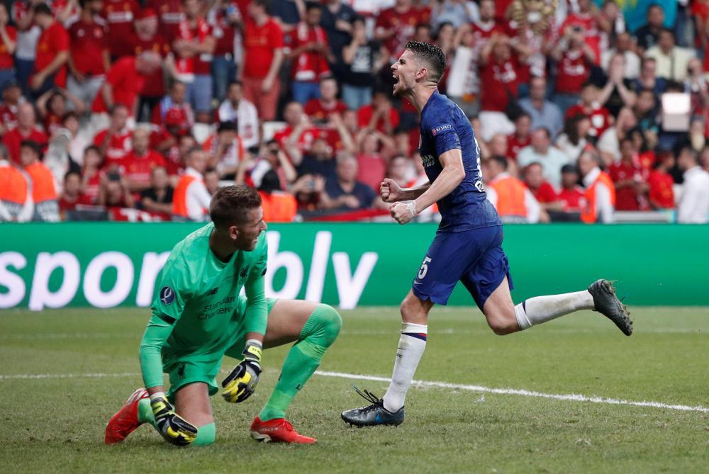 Jorginho celebrates scoring the second equaliser.