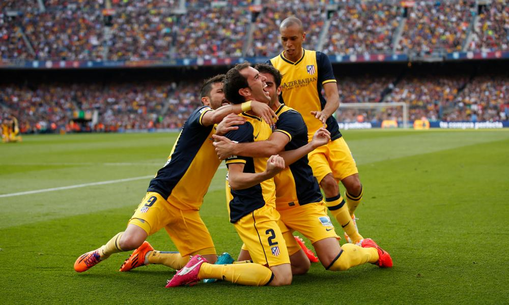 Diego Godín is congratulated by his Atlético Madrid team-mates after his equaliser against Barcelona that won the Spanish title at the Camp Nou in 2014