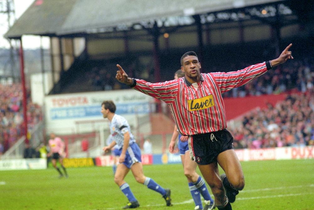 Brian Deane celebrates after scoring the first goal in the Premier League, against Manchester United at Bramall Lane.