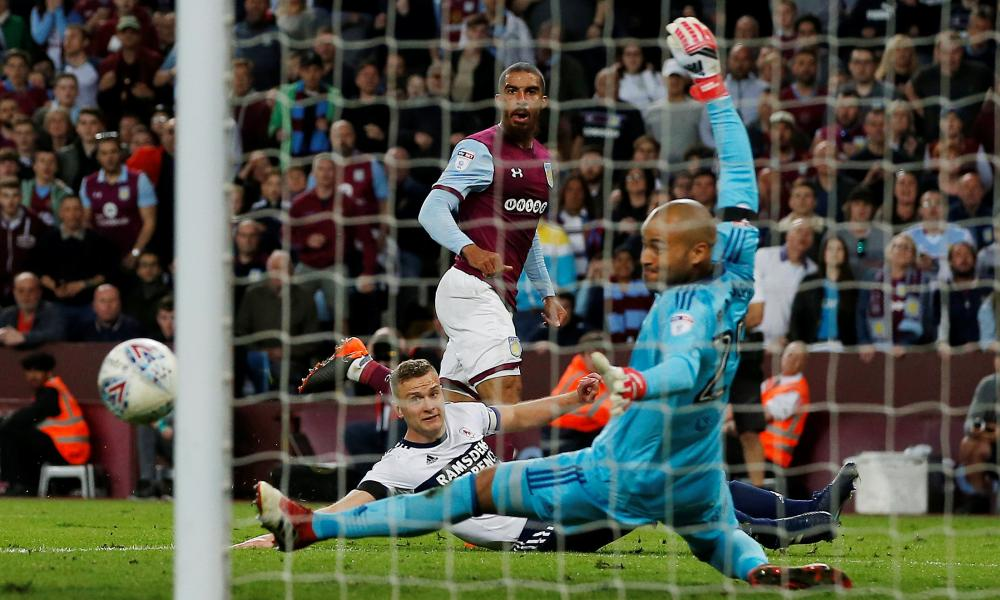 Once again Aston Villa's Lewis Grabban is thwarted by Boro keeper Darren Randolph.