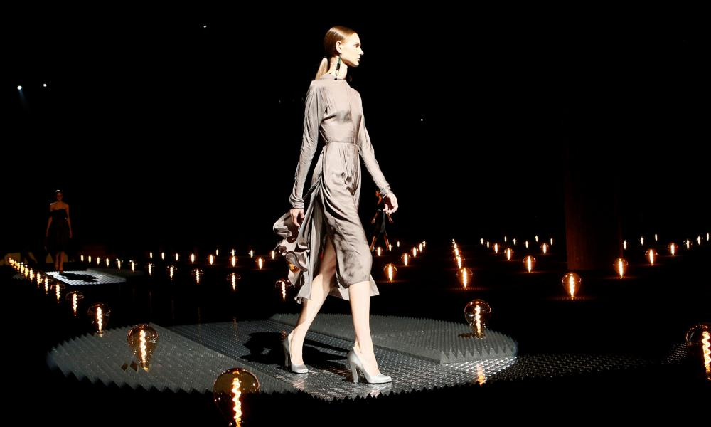 A model presents a creation by Prada.