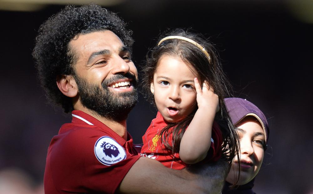 Salah celebrates with his daughter Makka and his wife Magi.