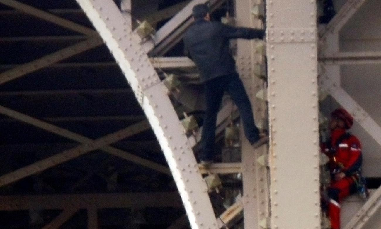 Eiffel Tower closed after man tries to climb Paris landmark