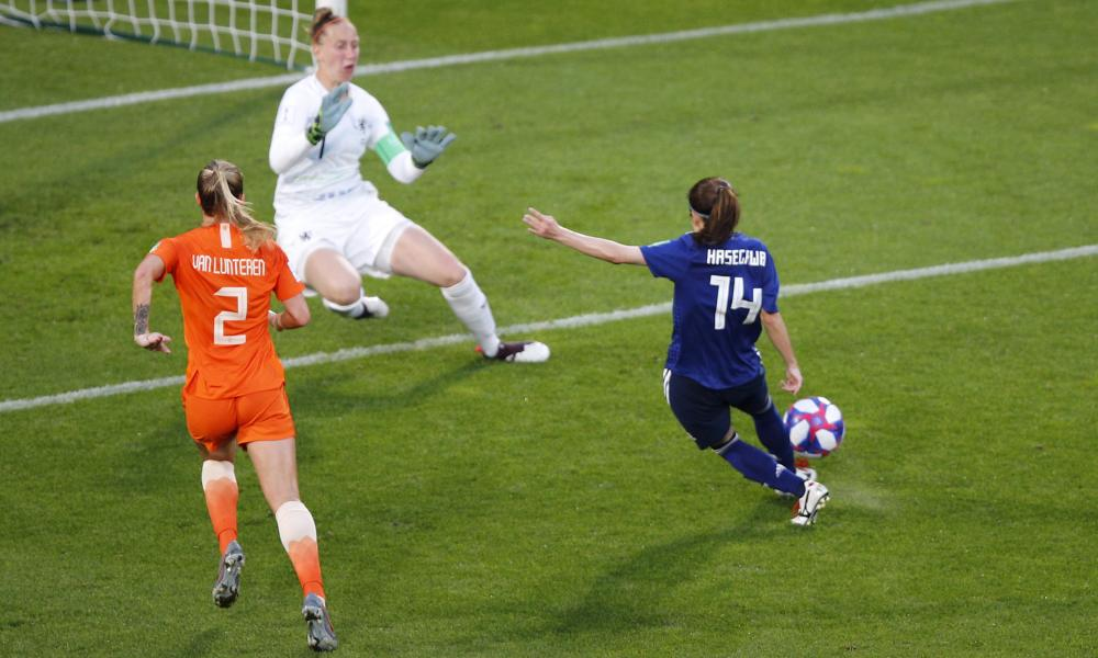 Japan's Yui Hasegawa, right, kicks the ball past Netherlands goalkeeper Sari Van Veenendaal to score her team's equaliser.