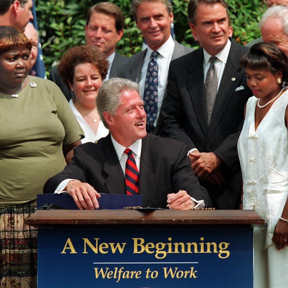 Bill Clinton prepares to welfare reform legislation in 1996.