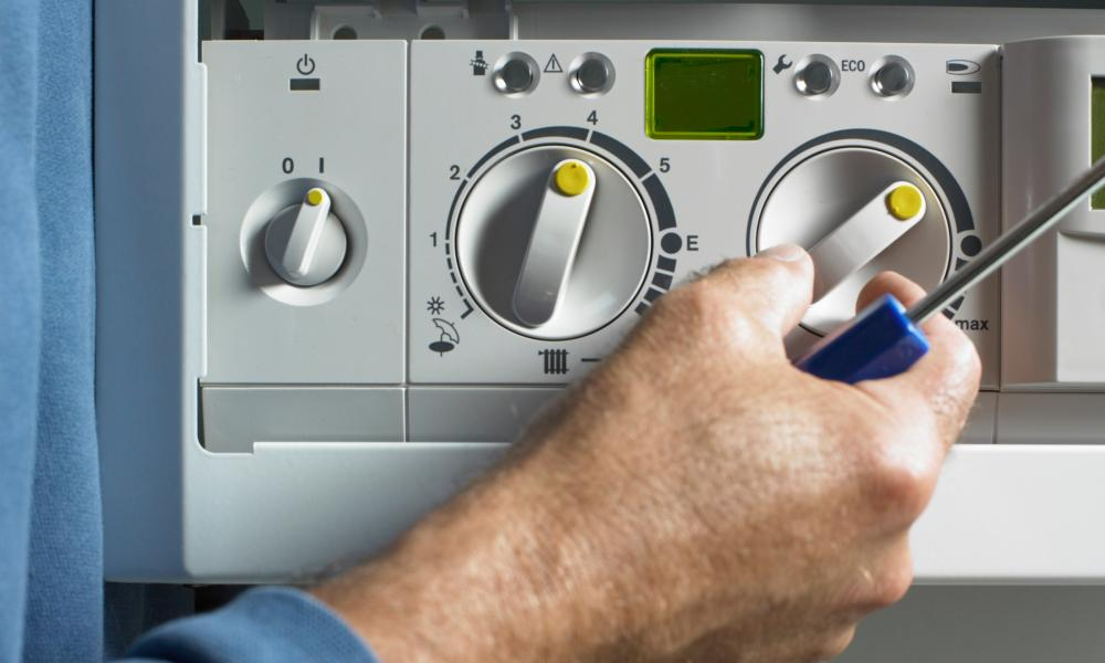 An engineer working on a gas boiler