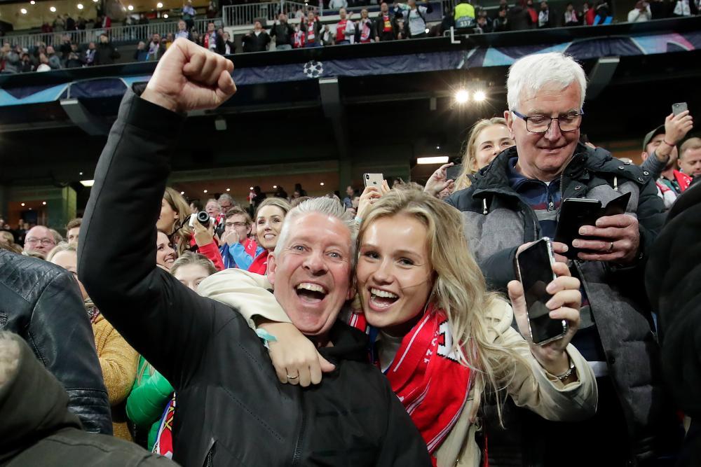 Frenkie de Jong's father John de Jong and Frenkie's girlfriend Mikky Kiemeney savour the victory.